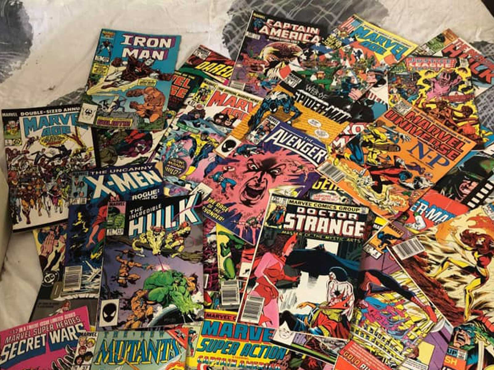 A table full of comic books.